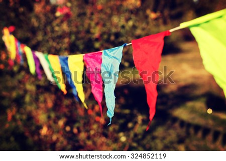 Festive decorations of colored flags. Toned style instagram filters - stock photo