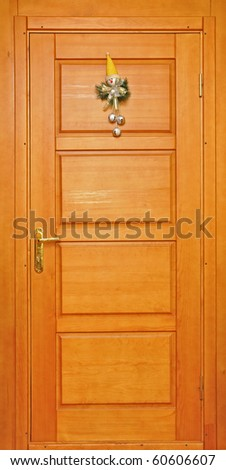 festive decorations snowman on the front door - stock photo