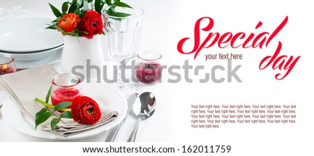 Festive dining table setting with red buttercup flowers, candles, napkins and shiny new cutlery in white. - stock photo