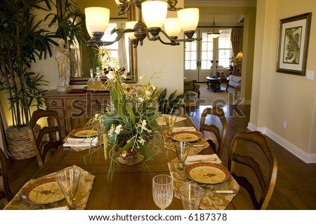 Festive dining table with a chandelier and luxurious decor.