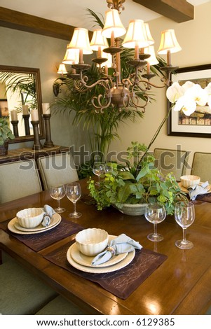 Festive dining table with luxurious dinnerware and decor.