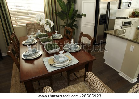 Festive dining table with luxurious tableware and decor.