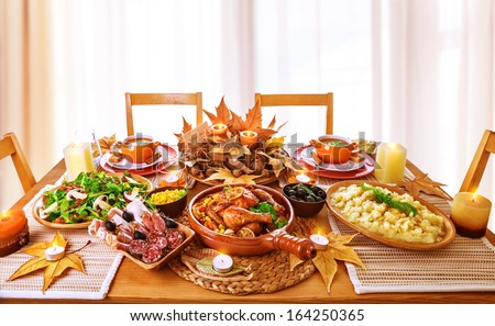 Festive dinner at home, Thanksgiving day celebration, backed chicken, cold cuts, potato garnish, fresh green salad, traditional food for autumnal holiday - stock photo