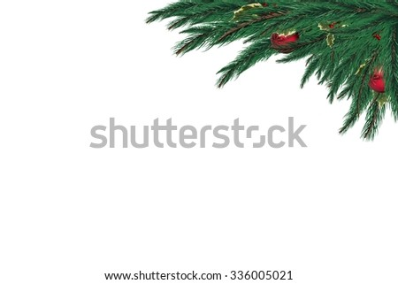 Festive fir branch with baubles on white background - stock photo
