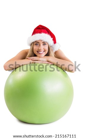 Festive fit blonde posing with exercise ball on white background - stock photo