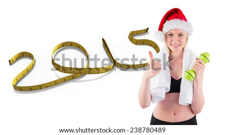 Festive fit blonde smiling at camera against 2015 in tape - stock photo