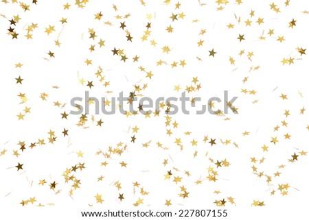 Festive flying gold stars shower - stock photo