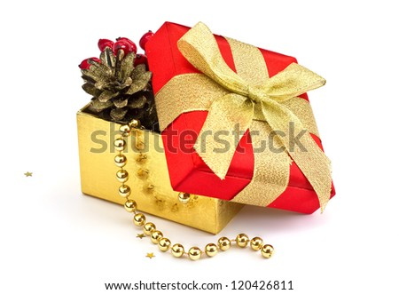 Festive gift box with christmas decoration isolated on white background - stock photo