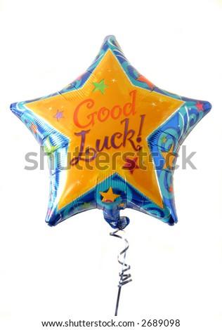 "Festive helium filled balloon with ""Good Luck"" written on it. - stock photo"
