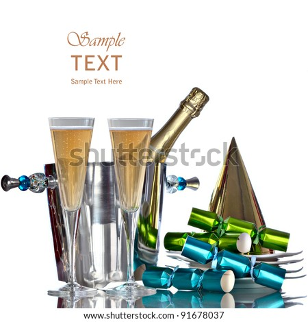 Festive Holiday Champagne In Silver Bucket Wine Cooler For Romantic New Years Celebration With White Plates, Gold Party Hat, and Green And Blue Party Favors