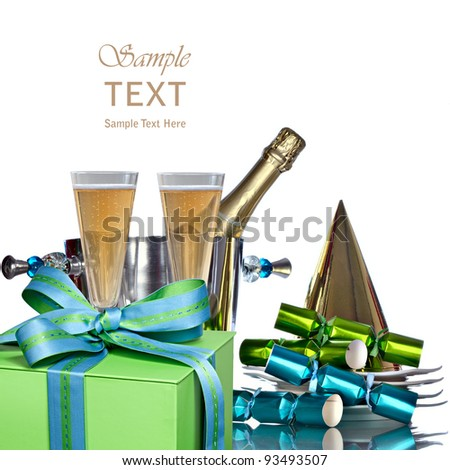 Festive Holiday Champagne In Silver Bucket Wine Cooler For Romantic New Years Celebration With Vintage White Plates, Gold Party Hat, Green & Blue Gift And Party Favors - stock photo