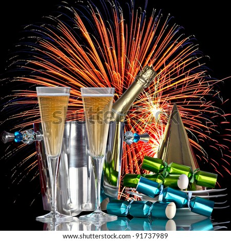 Festive Holiday Fireworks Celebration, Champagne Wine Bucket Cooler With Bottle, Party Hat, Favors and Romantic New Years Drinks - stock photo