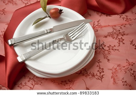 festive holiday place setting, plates, fork and knife, simple props