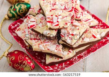 Festive holiday plate filled with chocolate peppermint bark candy