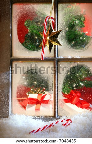 Festive holiday window with frost and snow - stock photo