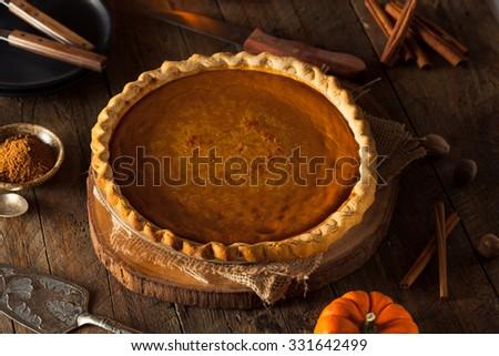 Festive Homemade Pumpkin Pie with Whipped Cream - stock photo