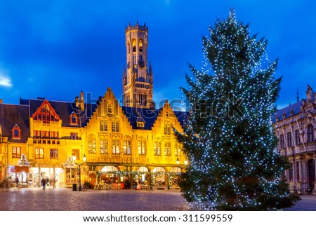 Festive illuminations and Christmas tree on the Burg Square in the Belgian city of Bruges. - stock photo