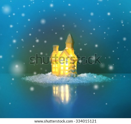 festive light in house with snow - stock photo