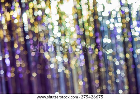 Festive Lights Bokeh. Abstract background spherical bokeh of colorful festive lights in shades of blue and purple.