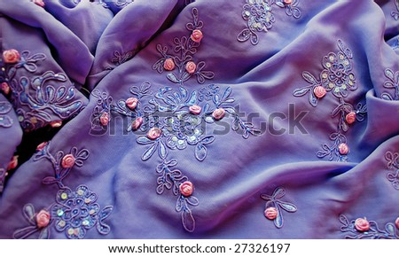 Festive lilac embroidered spangles and bead fabric. Sharpness in a center a picture - stock photo