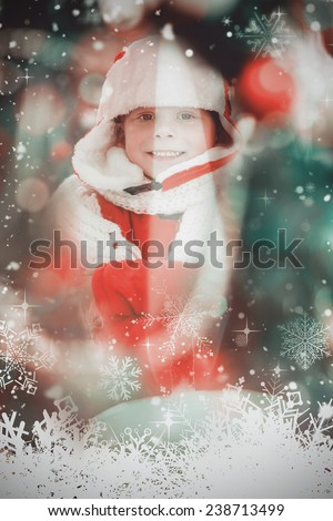 Festive little boy smiling at camera against candle burning against festive background