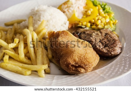 Festive menu of tasty chicken breast stuffed with ham and cheese with rice, fries and pork with sauce and mushrooms. Food theme. International cuisine. Large portion. - stock photo