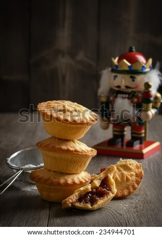 Festive mince pie stack with Christmas decoration - stock photo