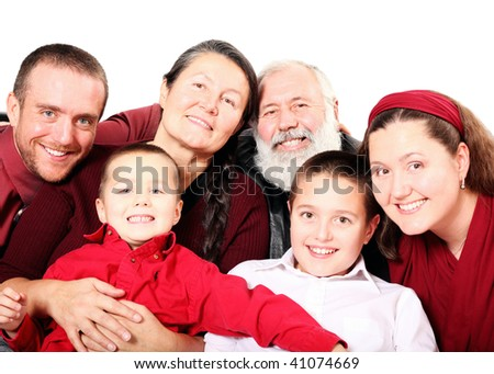 Festive multigenerational family portrait isolated on white - stock photo