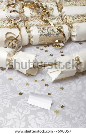 Festive party crackers with a blank note - insert your own message - stock photo