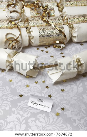 Festive party crackers with a Happy new year note - stock photo