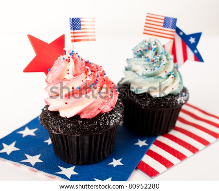 Festive Patriotic Cupcakes in Red, White, and Blue Colors - stock photo