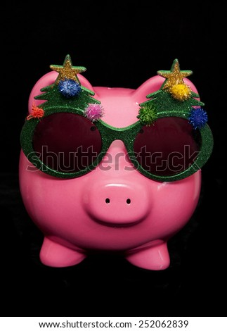 festive piggy bank studio cutout - stock photo