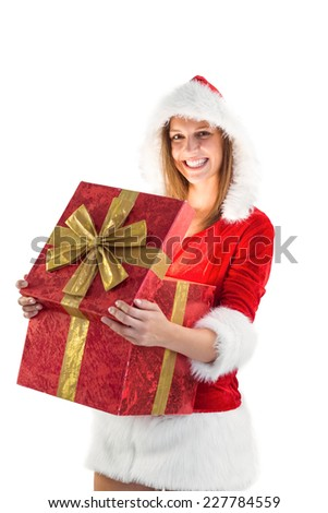 Festive pretty brunette opening a gift on white background