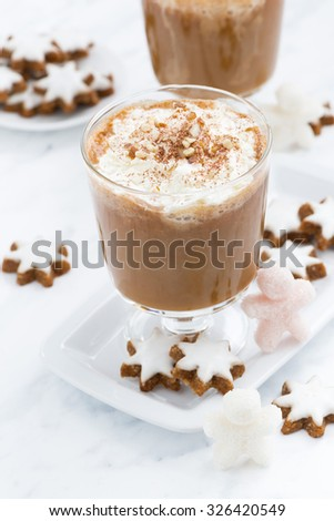 festive pumpkin latte and almond cookies on a white background, vertical, top view - stock photo