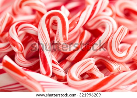 Festive red and white peppermint candy canes  background.  - stock photo