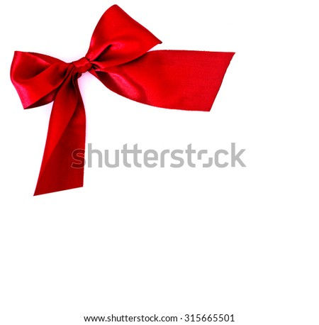 festive red bow on white background - copy space for text - stock photo