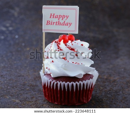 festive red velvet cupcakes with a gift compliment card - stock photo