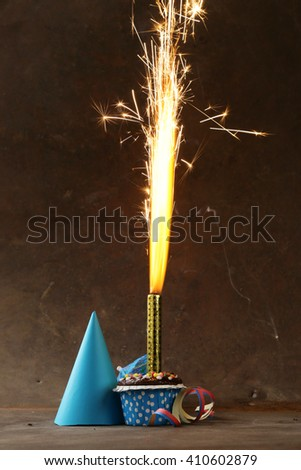 festive set for birthday party - candles, fireworks, desserts - stock photo