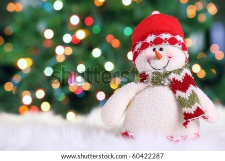 Festive snowman with Christmas light background - stock photo