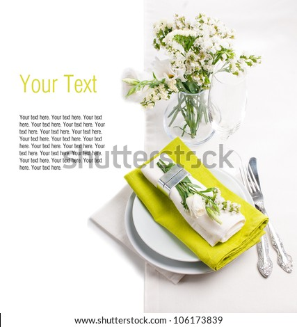 Festive table setting and decoration with fresh flowers in green - stock photo