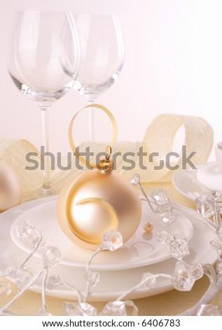 Festive table setting for Christmas- Christmas ornaments on table - stock photo