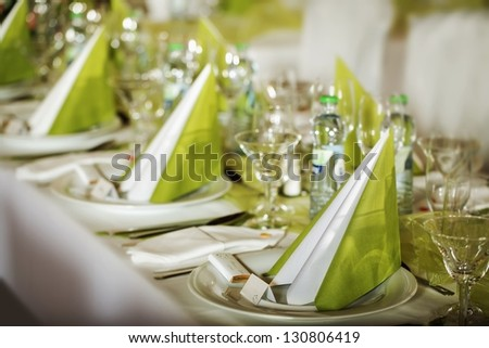 Festive table setting for wedding, Valentine or other event ( Empty place cards on the white festive table ) - stock photo