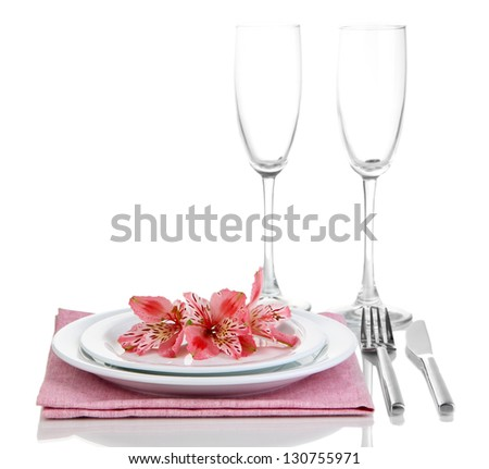 Festive table setting with flowers isolated on white - stock photo