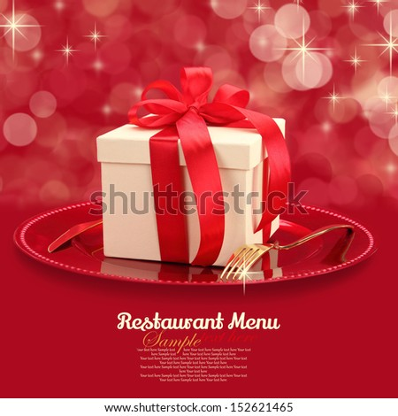 Festive table setting with gift box on a plate  - stock photo