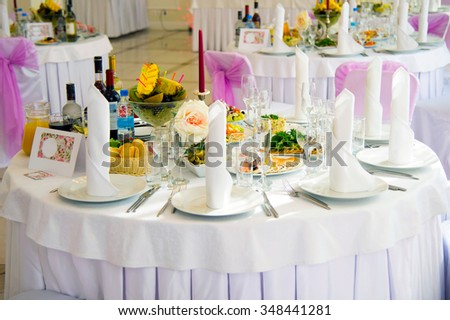 Festive table. Table setting. Festive round table with food.  Starched napkins and Cutlery. Festive meals. The restaurant inside. Service holidays. The design of the hall. - stock photo