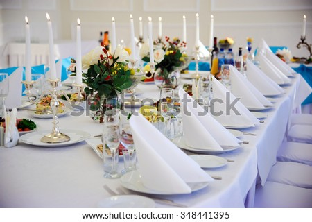 Festive table. Table setting. Festive round table with food.  Starched napkins and Cutlery. Festive meals. Restaurant inside. Service holidays. ?esign of the hall. - stock photo