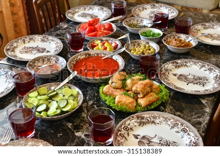 festive table with food and drink - stock photo