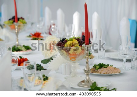 Festive table with food for a celebration. Banquet table with Cutlery and tableware. Table with white tablecloth served to guests. The table in the restaurant. Luxury Desk for the celebration. - stock photo