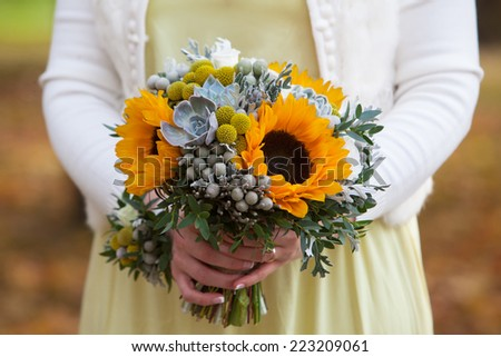 festive wedding bouquet in hands of the bride - stock photo