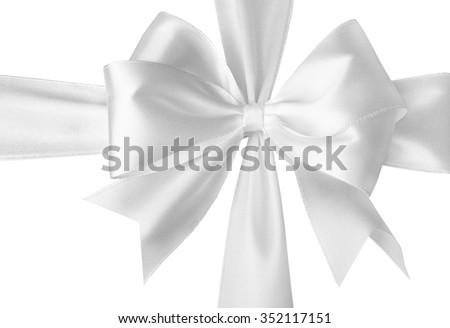 Festive white satin bow on a white background. - stock photo